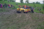 Spectators at the 1993 A.R.C. National Rally pushing a stuck Land Rover Series 2 based off-road racer back on track. The Association of Rover Clubs (A.R.C., since 2006 the Association of Land Rover Clubs ALRC) National Rally is the biggest annual motor sport oriented Land Rover event and was hosted 1993 by the Midland Rover Owners Club at Eastnor Castle in Herefordshire. --- No releases available. Automotive trademarks are the property of the trademark holder, authorization may be needed for some uses.