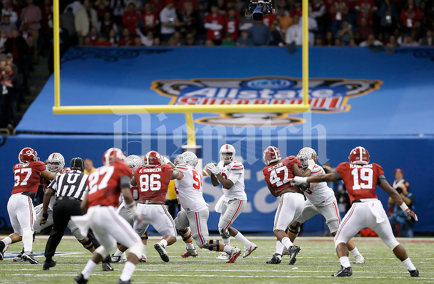 Ohio State Buckeyes quarterback Cardale Jones (12) drops back to pass during the second quarter in the Allstate Sugar Bowl college football playoff semifinal at Mercedes-Benz Superdome in New Orleans on Thursday, January 1, 2015. (Columbus Dispatch photo by Jonathan Quilter)