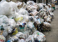 Bags of recyclable trash awaiting pick-up in the Chelsea neighborhood of New York on Saturday, March 18, 2017. As the snow melts from out recent storm the Dept. of Sanitation is starting to resume trash collection.  (© Richard B. Levine)