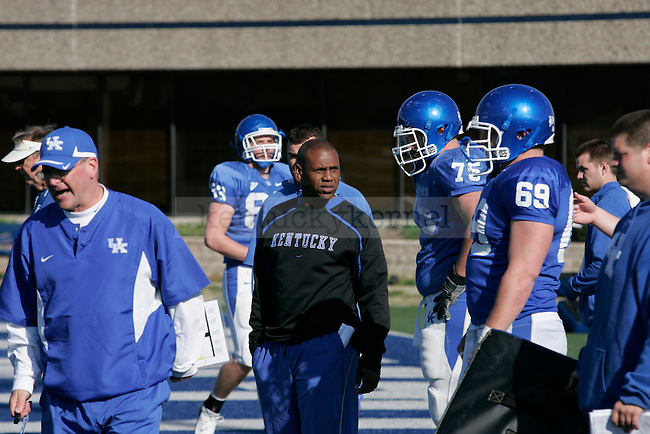 UK head football coach Joker Phillips talks with his team during practice at the Nutter Field House Practice Facility Friday morning. Photo by Scott Hannigan | Staff