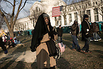 January 20, 2009. Washington, DC..Almost 2 million people packed the National Mall in sub freezing temperatures to witness the swearing in of Barack Obama, the 44th president of the united States and the first African American to hold the office. . People wrapped in blankets, coats and huddled together to try and keep warm in the hours leading up to the ceremonies. Elvirika Everson, of Charleston, SC, waved her flags to keep warm.