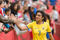 June 12, 2015: Nancy AGUILAR of Ecuador greets fans after a Group C match at the FIFA Women's World Cup Canada 2015 between Switzerland and Ecuador at BC Place Stadium on 12 June 2015 in Vancouver, Canada. Switzerland won 10-1. Sydney Low/AsteriskImages