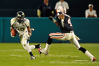 29 November 2008:  FIU wide receiver Jason Frierson (80) attempts to evade Florida Atlantic defensive back Carldayle Brantley (4) in the FAU 57-50 overtime victory over FIU in the annual Shula Bowl at Dolphin Stadium in Miami, Florida.