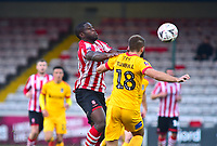 Lincoln City's John Akinde vies for possession with  Northampton Town's Jordan Turnbull<br /> <br /> Photographer Andrew Vaughan/CameraSport<br /> <br /> Emirates FA Cup First Round - Lincoln City v Northampton Town - Saturday 10th November 2018 - Sincil Bank - Lincoln<br />  <br /> World Copyright &copy; 2018 CameraSport. All rights reserved. 43 Linden Ave. Countesthorpe. Leicester. England. LE8 5PG - Tel: +44 (0) 116 277 4147 - admin@camerasport.com - www.camerasport.com