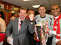 Stevenage manager Graham Westley celebrates with his backroom staff in the dressing room after winning the npower League 2 play-off final between Stevenage and Torquay United at Old Trafford, Manchester on 28th May, 2011.© Kevin Coleman 2011.