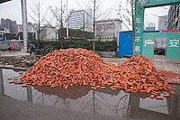 Daytime Landscape View Of A Pile Of Bricks In A Road In Chongqing, China.  © LAN