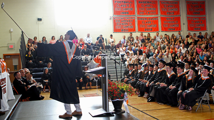 Watertown, CT-061915MK05 Harun Malik takes a selfie with his classmates after giving reflection comments during the 2015 Commencement Exercises at Watertown High School Friday evening. Michael Kabelka / Republican-American