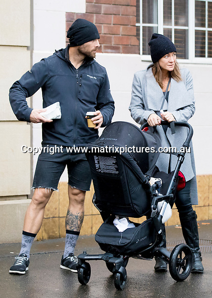 19 JUNE 2016 SYDNEY AUSTRALIA<br /> WWW.MATRIXPICTURES.COM.AU<br /> <br /> EXCLUSIVE PICTURES<br /> <br /> Michelle Bridges pictured with Steve Willis and their baby Axel on a rainy Sunday having a meal at a Potts Point Cafe before heading home. <br /> <br /> *ALL WEB USE MUST BE CLEARED*<br /> <br /> Please contact prior to use:  <br /> <br /> +61 2 9211-1088 or email images@matrixmediagroup.com.au <br /> <br /> Note: All editorial images subject to the following: For editorial use only. Additional clearance required for commercial, wireless, internet or promotional use.Images may not be altered or modified. Matrix Media Group makes no representations or warranties regarding names, trademarks or logos appearing in the images.