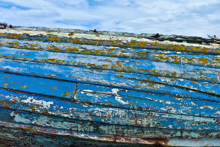 Faded aquamarine paint colour of a dilapidated fishing boat, County Clare, West Coast of Ireland