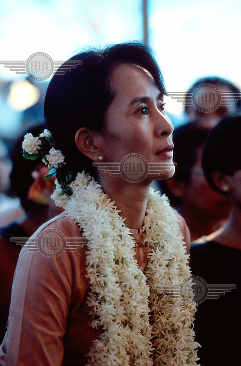 Daw Aung San Suu Kyi, Nobel Peace Prize Laureate and General Secretary of the National League for Democracy (NLD), sitting among supporters during the celebrations for Burmese New Year in the grounds of her home.
