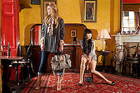 NO REPRO FEE.30/8/2010. AWEAR AUTUMN COLLECTION.EXCLUSIVE PICTURES FOR IRISH TIMES.(To accompany Deirdre McQuillans article) Yomiko Chen & Sarah Morrissey model a selection of dresses from A wear's new autumn '10 collection at Kehoes Pub in Dublin. Sarah wears Swing grey coat - EUR80, Printed Blouse - EUR30 Skinny denims - EUR30 and Satchel bag - EUR35 .Yomiko Chen wears Printed dress - EUR45 and a Black studded bag - EUR25 The collection arrives instore and on www.awear.comfrom this week. Picture James Horan/Collins Photos