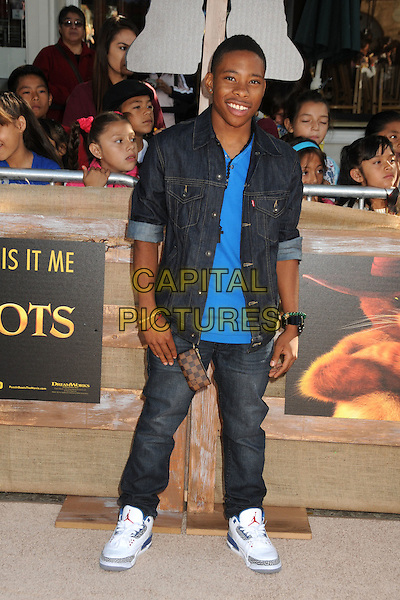 Carlon Jeffery.The L.A. Premiere of 'Puss in Boots' held at The Regency Village Theatre in Westwood, California, USA..October 23rd, 2011.full length blue shirt jeans denim black.CAP/ADM/BP.©Byron Purvis/AdMedia/Capital Pictures.