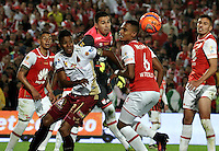 BOGOTA - COLOMBIA - 18-12-2016: Leonardo Castellanos (C) and William Tesillo (R) players of Independiente Santa Fe struggles for the ball with Faider Torrijano (L) player of Deportes Tolima, during a match for the second leg between Independiente Santa Fe and Deportes Tolima, for the final of the Liga Aguila II -2016 at the Nemesio Camacho El Campin Stadium in Bogota city, Photo: VizzorImage / Luis Ramirez / Staff.