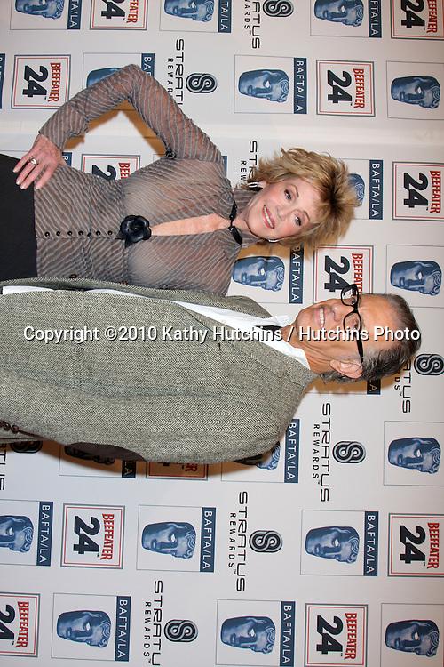 Jane Fonda & Guest.arriving at the BAFTA/LA Awards Season Tea Party 2010.Beverly Hills Hotel.Beverly Hills, CA.January 16, 2010.©2010 Kathy Hutchins / Hutchins Photo....