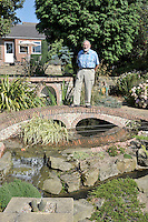 Nottingham, United Kingdom, Frank GOODMAN, stands on the garden water feature he designed with a scaled proportional water flow as at the Nottingham slalom  Course   Saturday 12/09/2009, England  [Mandatory Credit. Peter Spurrier/Intersport Images]