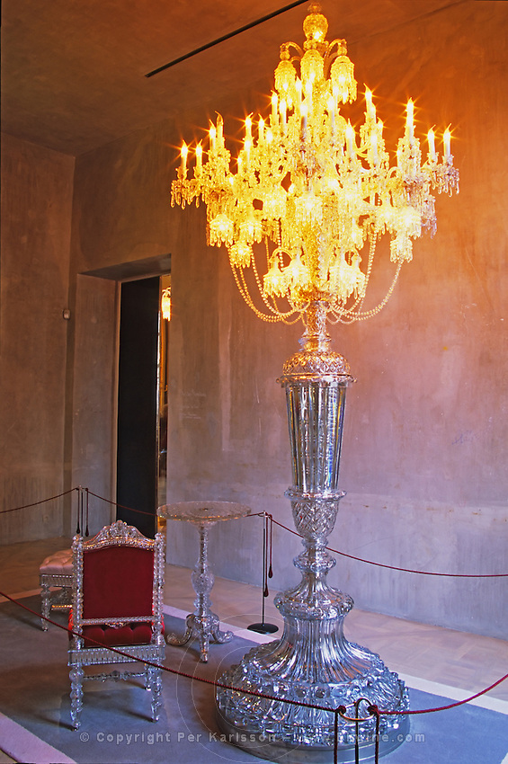 One of the museum piece giant candelabra and crystal chair and table, collector's item made for maharajas and sheiks, in plush red velvet. At The Baccarat museum, shop, restaurant at the Hotel de Noailles in Paris. Designed by Philippe Starck.