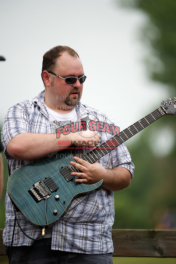 Cover band Friction guitarist Joe Guevara performs before a Kane County Cougars game against the Burlington Bees at Fifth Third Bank Ballpark on June 28, 2012 in Geneva, Illinois.  Kane County defeated Burlington 6-5.  (Mike Janes/Four Seam Images)