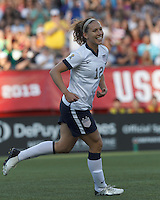 USWNT midfielder Lauren Cheney (12) reacts to her goal. In an international friendly, the U.S. Women's National Team (USWNT) (white/blue) defeated Korea Republic (South Korea) (red/blue), 4-1, at Gillette Stadium on June 15, 2013.