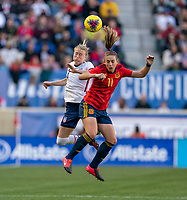 HARRISON, NJ - MARCH 08: Emily Sonnett #14 of the United States goes up for a header with Alexia Putellas #11 of Spain during a game between Spain and USWNT at Red Bull Arena on March 08, 2020 in Harrison, New Jersey.