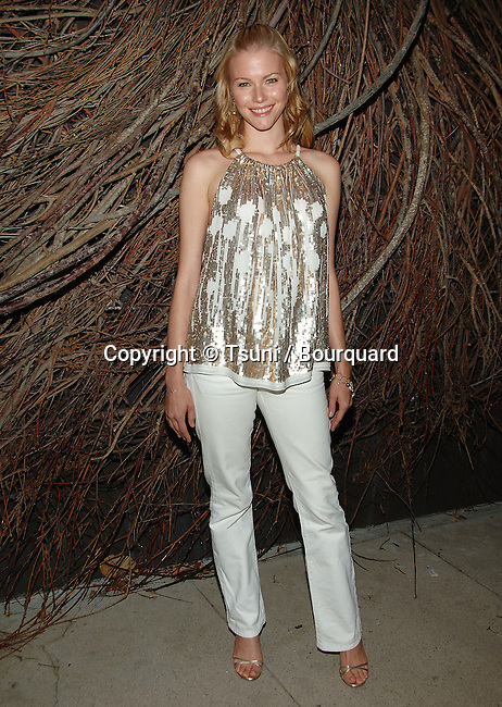 Melissa Sagemiller  arriving at the Lubov Azria debut of the Panthera jewelry Collection at the Max Azria Boutique in Los Angeles.<br /> <br /> full length<br /> eye contact<br /> smile