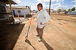 "24 JANUARY 2010 -- WENDEN, AZ:  Jose Montes, (CQ) a 14 year resident of Wenden, takes a break while cleaning the front of his home. During the break he said, ""This is a lot of work for one person."" Wenden was slammed by its second 100 year flood in 10 years on Thursday night when water raced through Centennial Wash and into the small town in La Paz County west of Phoenix. Most of the town's residents were evacuated to Red Cross shelters in Salome, about 5 miles west of Wenden.     PHOTO BY JACK KURTZ"