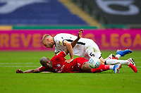 18th July 2020; Liberty Stadium, Swansea, Glamorgan, Wales; English Football League Championship, Swansea City versus Bristol City; Benik Afobe of Bristol City and Mike van der Hoorn of Swansea City challenge for the ball