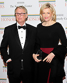It was announced today that famed Director Mike Nichols passed away suddenly on Wednesday, November 20, 2014 at age 83.  In this file photo from December 3, 2012, he is pictured with his wife, Diane Sawyer, as they arrive for the formal Artist's Dinner honoring the recipients of the 2011 Kennedy Center Honors at the United States Depart of State.<br /> Credit: Ron Sachs / CNP
