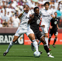 Real Madrid defender (3) Pepe collides with DC United forward (11) Luciano Emilio during their friendly at FedEx Field in Landover, Maryland.  Real Madrid defeated DC United, 3-0.