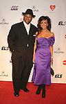 LOS ANGELES, CA. - January 29: Jimmy Jam (L) and wife Lisa Harris arrive at the 2010 MusiCares Person Of The Year Tribute To Neil Young at the Los Angeles Convention Center on January 29, 2010 in Los Angeles, California.