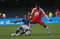 BOGOTÁ - COLOMBIA, 20-01-2019:Andres Perez (Der.) jugador del Independiente Santa Fe disputa el balón con Mackalister Silva (Izq.) jugador de Millonarios durante partido por la  final del Torneo Fox Sport 2019 jugado en el estadio Nemesio Camacho El Campín de la ciudad de Bogotá. /Andres Perez (R) Player of the Independiente Santa Fe disputes the ball with Mackalister Silva (L) player of Millonarios during game for the final of the Fox Sport 2019 Tournament played in the Nemesio Camacho El Campín stadium in the city of Bogotáy. Photo: VizzorImage / Felipe Caicedo / Staff.