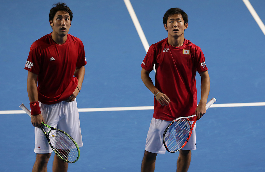 Yasutaka Uchiyama and partner Yoshihito Nishioka wait for hawk-eye to decide a line call during their doubles rubber against Andy Murray and Jamie Murray today - Andy Murray and Jamie Murray (GBR) def Yoshihito Nishioka and Yasutaka Uchiyama (JPN) 6-3 6-2 6-4<br /> <br /> Photographer Stephen White/CameraSport<br /> <br /> International Tennis - 2016 Davis Cup by BNP Paribas - World Group First Round - Great Britain v Japan - Day 2 - Saturday 5th March 2016 - Barclaycard Arena, Birmingham, Great Britain<br /> <br /> &copy; CameraSport - 43 Linden Ave. Countesthorpe. Leicester. England. LE8 5PG - Tel: +44 (0) 116 277 4147 - admin@camerasport.com - www.camerasport.com.