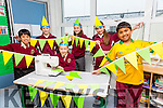 Moyderwell NS students  l-r Lance Perez, Cliona O'Connor McCarthy, Kate Kerins, Mairead McCarthy, Andrea Fitzgerald, Fahad Azim making Hand made bunting using a sewing machine in the classroom for the Kerry all Ireland final