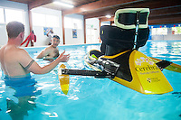 COPY BY TOM BEDFORD<br /> Sunday 26 June 2016<br /> Pictured: The boat used in the race while being tested in the university pool<br /> Re: A very special father-and-daughter team have tackled the Cardiff Triathlon.<br /> Poppy Jones, 11, who will be competing alongside dad Rob Jones, wants to win the event.<br /> And she's not going to let the fact that she has quadriplegic cerebral palsy , which means she can't sit, stand, roll or support herself, and chronic lung disease stop her.<br /> She will be by Rob's side every step of the way thanks to a cutting-edge wheelchair and boat – for Rob to push or pull – designed especially for the event, which sees participants take part in a swim across Cardiff Bay , a run and a bike ride.