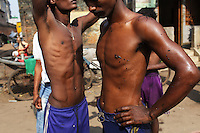 Two Indian men standing in the street in central Kolkata. India. November, 2013