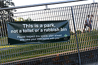 'This is a park not a rubbish bin banner' displayed in Regents Park during the coronavirus pandemic