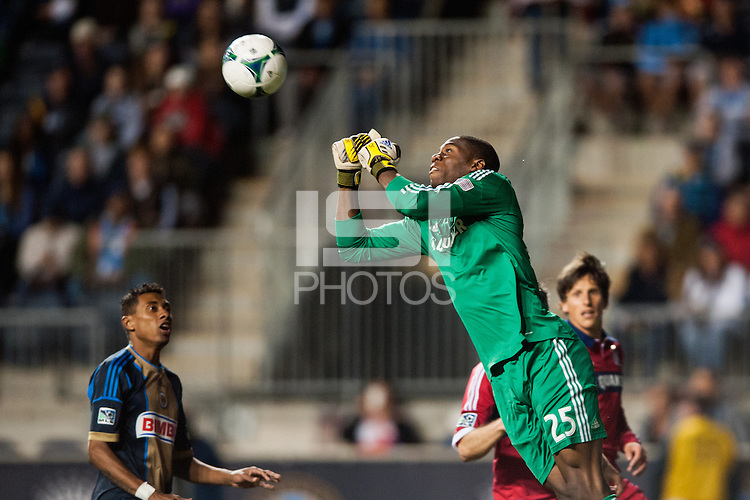 Chicago Fire goalkeeper Sean Johnson (25) punches a ball clear. The Philadelphia Union defeated the Chicago Fire 1-0 during a Major League Soccer (MLS) match at PPL Park in Chester, PA, on May 18, 2013.