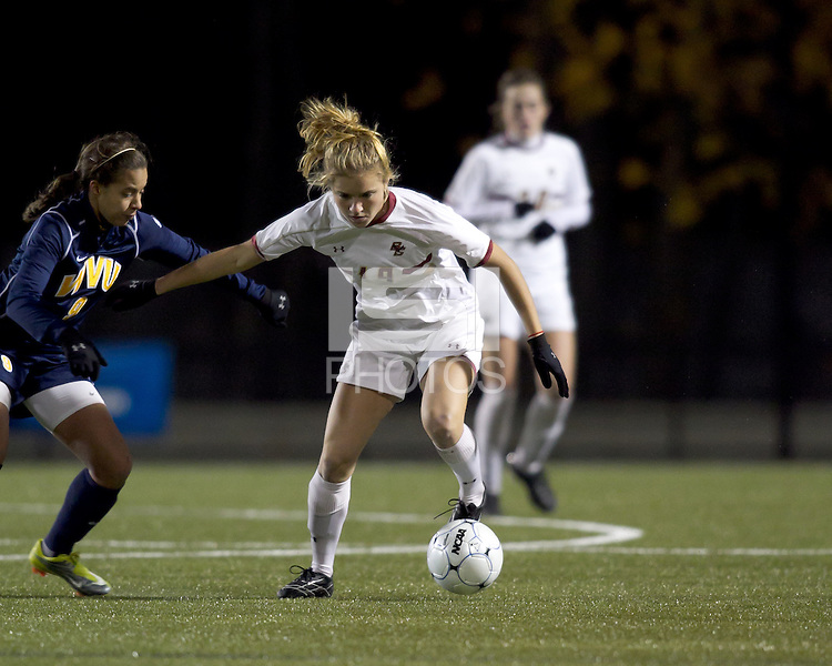 "Boston College forward Kristen Mewis (19) controls the ball as West Virginia forward Frances Silva (9) pressures. Boston College defeated West Virginia, 4-0, in NCAA tournament ""Sweet 16"" match at Newton Soccer Field, Newton, MA."