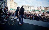 Geraint Thomas (GBR/SKY) interviewed as one of the race favorites in front of a large crowd gathered in front of the start podium.<br /> John Degenkolb (DEU/Giant-Alpecin) awaits his turn.<br /> <br /> 99th Ronde van Vlaanderen 2015