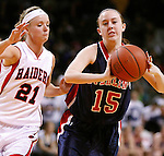 SIOUX CITY, IA - MARCH 13, 2009 --   Erica Herman #15 of Sterling College gets past defender Kami Kuhlmann #21 of Northwestern College (IA) during their game at the 2009 NAIA DII Women's Basketball National Championship at the Tyson Events Center. (Photo by Dick Carlson/Inertia)