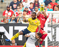 CHARLOTTE, NC - JULY 20: Alexandre Lacazette #9 and Federico Ceccherini #5 go for the ball as goalkeeper Bartlomiej Dragowski #1 punches the ball out during a game between ACF Fiorentina and Arsenal at Bank of America Stadium on July 20, 2019 in Charlotte, North Carolina.
