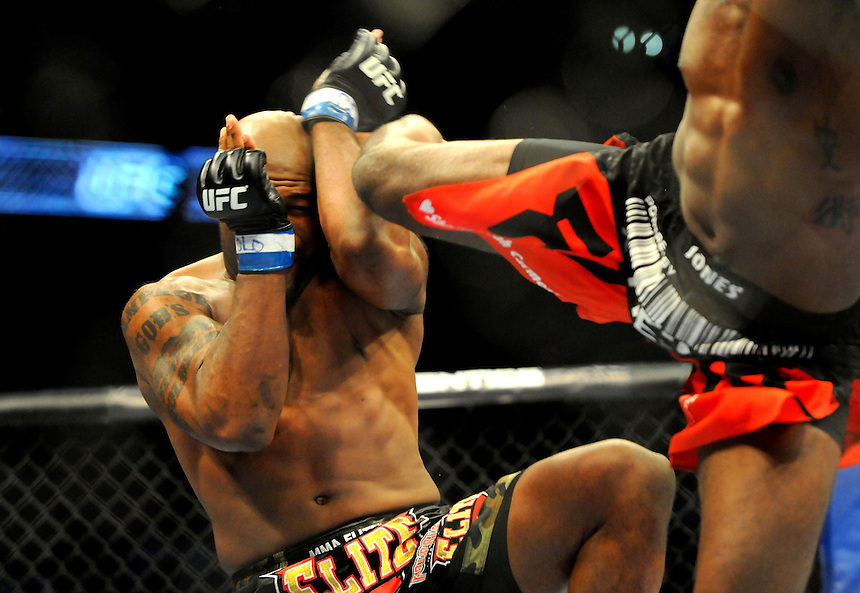 "24 SEPTEMBER 2011:  Quinton ""Rampage"" Jackson takes a kick in the head during the bout against Jon ""Bones"" Jones   during UFC 135 at the Pepsi Center in Denver, Colorado. *****For Editorial Use Only*****"