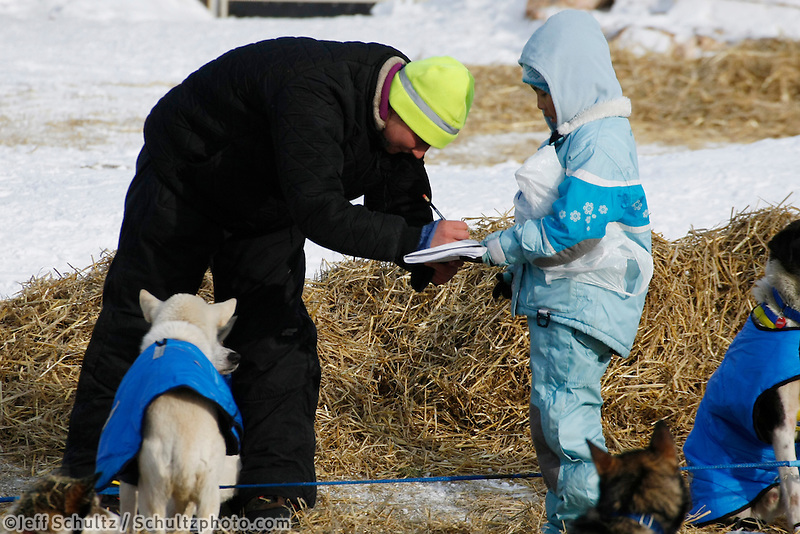 Melissa Owens signs an autograph at the Shageluk checkpoint on Saturday morning    Iditarod 2009