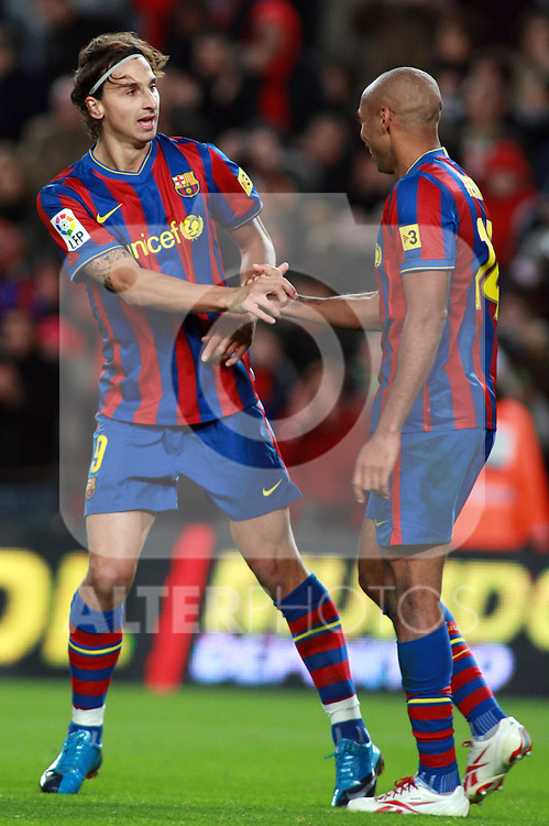 Football Season 2009-2010. Barcelona's player Zlatan Ibrahimovic greating Thierry Henry for his goal during the Spanish first division soccer match at Camp Nou stadium in Barcelona November 07, 2009.