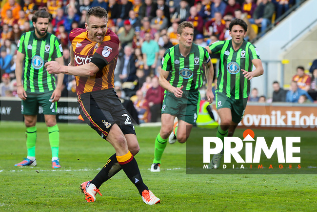 Tony McMahon of Bradford City scores the first goal of the game from the penalty spot during the Sky Bet League 1 match between Bradford City and AFC Wimbledon at the Northern Commercial Stadium, Bradford, England on 22 April 2017. Photo by Thomas Gadd.