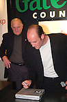 Gateway CEO Ted Waitt signs a Gateway 3450 laptop at the launch celebration of Windows XP at the Gateway Country Store October 24, 2001 in New York. Windows XP is the latest operating system from  Microsoft. (Photo by Lawrence Lucier)