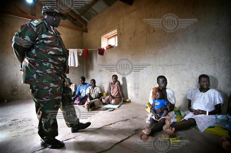 """The director of Rumbek prison watches over female inmates detained for adultery crimes. Local women are frequently accused of adultery, which is illegal, by their husbands and many of them end up incarcerated at Rumbek prison as a result. The jailing of women for """"adultery"""" is often linked to dowry and other marital disputes. Occasionally, women committed to arranged marriages themselves attempt to be jailed for adultery crimes in order to provoke their husbands into granting them a divorce."""