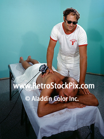 Man getting a massage at the El Coronado Motel in Wildwood New Jersey. 1960's