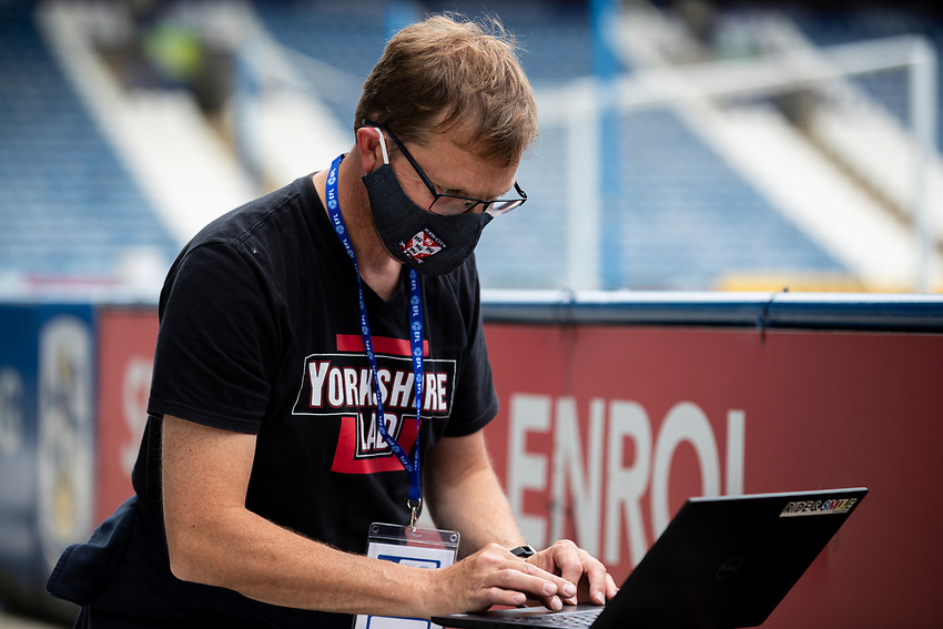 A photographer with The Yorkshire Post works during match<br /> <br /> Photographer Alex Dodd/CameraSport<br /> <br /> The EFL Sky Bet Championship - Huddersfield Town v Wigan Athletic - Saturday 20th June 2020 - John Smith's Stadium - Huddersfield <br /> <br /> World Copyright © 2020 CameraSport. All rights reserved. 43 Linden Ave. Countesthorpe. Leicester. England. LE8 5PG - Tel: +44 (0) 116 277 4147 - admin@camerasport.com - www.camerasport.com