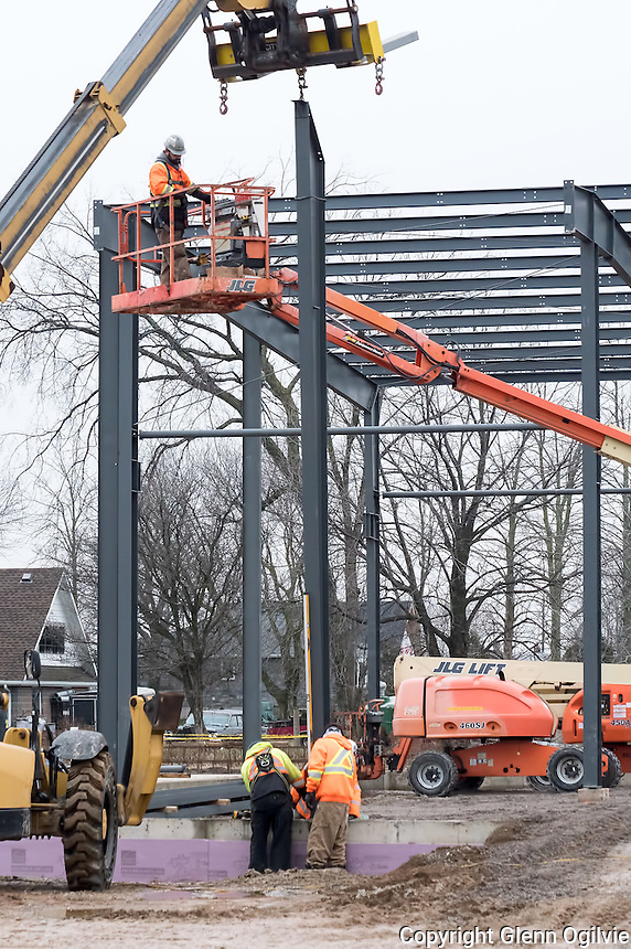 Workers erect the steel framework for a new <br /> 11,000-square-foot Carpenters Union Local 1256 training facility in the City's Sarnia&rsquo;s 402 Business Park.<br /> <br /> <br /> Union Gas and the Carpenters&rsquo; Union Local 1256 have each purchased land in the municipally-owned park, which is sandwiched between London Line and Highway 402 east of Airport Road.<br /> <br /> The Carpenters bought an additional two acres for $114,000 on Business Park Drive, directly across the street from the union&rsquo;s existing headquarters.<br /> <br /> The proposed training facility will be roughly 11,000-square-feet and could open by the end of this year.<br /> <br /> Union Gas, which is about to become the third enterprise in the largely vacant business park, has been issued a $4.2 million building permit.<br /> <br /> The utility&rsquo;s plans call for a new operations centre with offices and warehouse space.