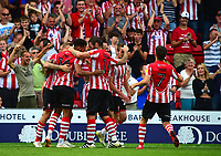 Lincoln City's Harry Toffolo celebrates scoring his sides third goal with team mates<br /> <br /> Photographer Andrew Vaughan/CameraSport<br /> <br /> The EFL Sky Bet League Two - Lincoln City v Swindon Town - Saturday August 11th 2018 - Sincil Bank - Lincoln<br /> <br /> World Copyright &copy; 2018 CameraSport. All rights reserved. 43 Linden Ave. Countesthorpe. Leicester. England. LE8 5PG - Tel: +44 (0) 116 277 4147 - admin@camerasport.com - www.camerasport.com